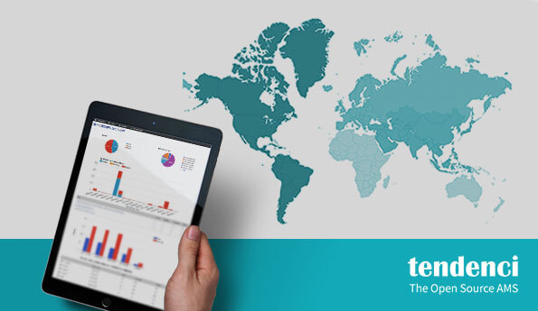 Hand holding tablet of Tendenci responsive graph reports